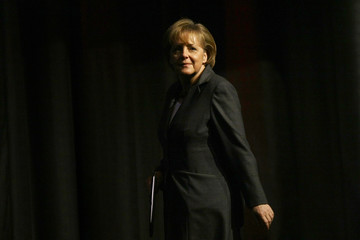 German Chancellor Merkel comes on the stage to deliver her speech during a New Year's reception in Mainz