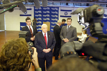 Israeli Prime Minister, Ariel Sharon speaks with the media after casting his vote in a polling ...