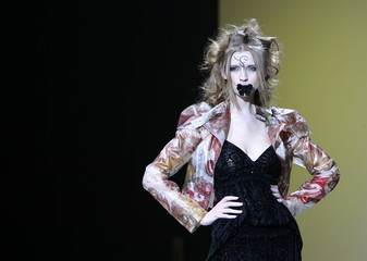 A models presents creations by Ukrainian designer Alexander Vasilyev during the Fashion Week in Moscow