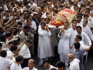 SONS OF INDIA'S INDUSTRIALIST DHIRUBHAI AMBANI CARRY THEIR FATHER'SBODY IN BOMBAY.