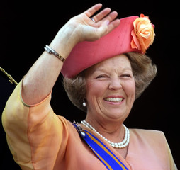 Dutch Queen Beatrix waves to well-wishers from the balcony of the Palace Noordeinde after presenting..