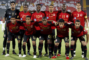 Al-Rayyan team players pose for a group photo before their match against Al-Rayyan during the Qatar Stars League soccer match in Doha