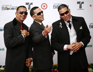 Members of the group Casa de Leones arrive at the red carpet of the 2008 Billboard Latin Music Awards in Hollywood, Florida