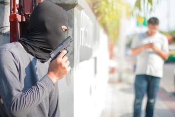 The robber has guns,Villains have guns,