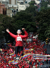 Supporters of Venezuelan President Hugo Chavez carry a giant puppet of him during a rally in Caracas