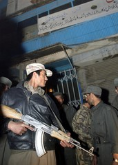 AN AFGHAN POLICEMAN GUARDS THE ENTRANCE OF A BLOCK FROM WHERE A BLASTOCCURED IN KABUL.