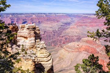 Close-up of the viewing area at Mather point where people are enjoying uninterrupted views of the majestic Grand Canyon National Park in Arizona, USA.