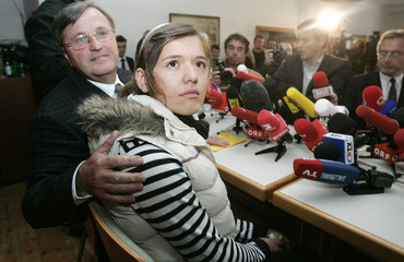 Kosovo girl Zogaj and reverend Friedl pose for photogaphers at the beginning of a news conference in Ungenach