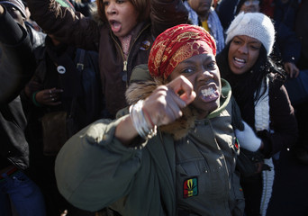 A woman protests during a rally against the recent shooting of Sean Bell in New York