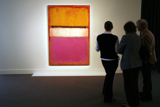 People view painting titled White Center by Mark Rothko, valued at more than $40 million, is displayed at Sotheby's auction house prior to upcoming sales featuring Impressionist, Modern and Contemporary art, in New York