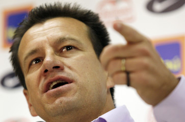 Brazilian coach Dunga gestures during a news conference in Rio de Janeiro