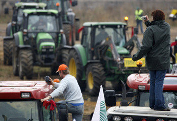 A French farmer takes picture of tractors in Metz, eastern France, during a nation wide day of protest