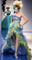 A model presents this creation as part of Japanese designer Yumi Katsura's spring-summer 2005 coutur..