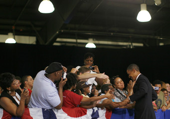 US Democratic presidential candidate Senator Obama greets supporters as he arrives for a town hall meeting in Raleigh