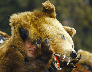 A man in a bear costume participates in the Lole parade, a traditional German event from the 17th century, in the Transylvanian town of Agnita