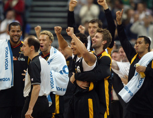 Germany's players celebrate victory against Slovenia during European basketball championship in Belgrade