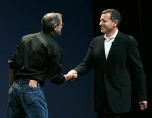 Apple CEO Steve Jobs greets Disney CEO Bob Iger in San Francisco
