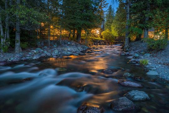Snyder Creek at Night - A spring night view of Snyder Creek at Lake McDonald Lodge. Glacier National Park, Montana, USA.