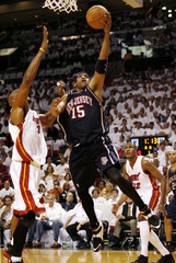 New Jersey Nets' Carter scores under pressure from Miami Heat Mourning in NBA basketball playoff series in Miami