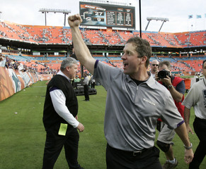 Ravens head coach Harbaugh reacts after his team defeated the Dolphins in their NFL Wild Card football game in Miami