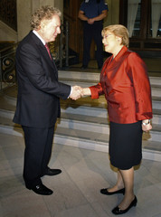 Quebec's Premier Jean Charest shakes hands with Chile's President Michelle Bacheletin before a meeting Quebec City