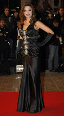 Television host Quetier arrives at the Cannes festival palace to attend the NRJ Music Awards