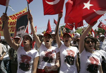 Turkish people wave Turkish flags during an anti-government rally in the Black Sea city of Samsun