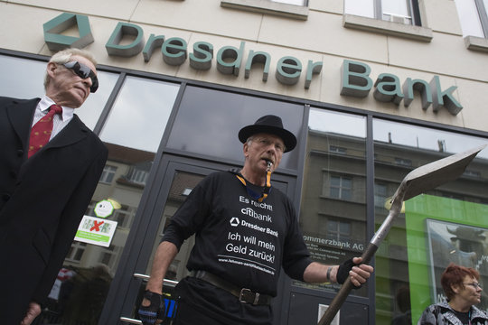 Small investors who lost money due to the collapse of the Lehman Brothers investment bank protest in front of a Dresdner branch in Berlin