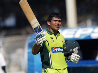 Akmal of Pakistan raises bat to acknowledge crowd after completing century against England in Karachi