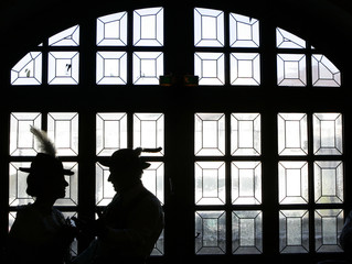 A couple in traditional Bavarian clothes is pictured silhouetted in Munich