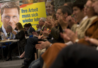 Delegates applaud during an extraordinary party convention of the liberal Free Democratic Party (FDP) in Potsdam