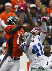 Denver Broncos Brandon Marshall catches the game-winning touchdown pass over Dallas Cowboys cornerback Terence Newman in NFL football game in Denver