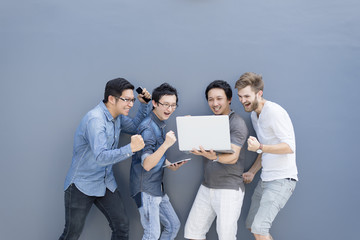 Group Of Asian and Multiethnic Business people man with casual suit using laptop with happy and celebrate action at the outdoor, people business group concept. Feeling funny and enjoy.