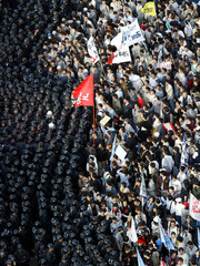 Riot police block protesters trying to march to National Assembly in Seoul April 2, 2003. South Kore..