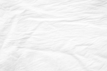 Wrinkled white cotton canvas fabric textured background, wallpaper