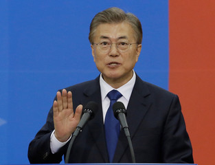 Newly elected South Korean President Moon Jae-in takes an oath during his inauguration ceremony at the National Assembly in Seoul, South Korea