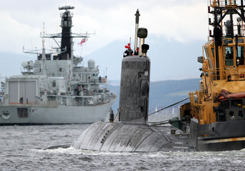HMCS Chicoutimi arrives at the Clyde Submarine Base at Faslane in Scotland.