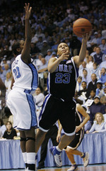Duke University's Smith drives to the basket for two points against the University of North Carolina's Little in Chapel Hill