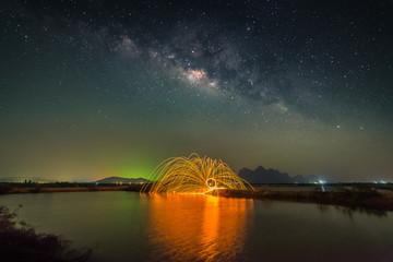 Milky way with fireworks