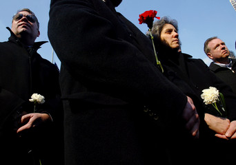 Friends and family gather at memorial for victims of 1993 World Trade Center bombing.