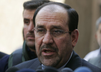 Iraq's Prime Minister al-Maliki speaks to reporters during a visit to Najaf