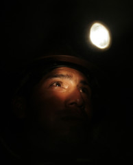 """A Bolivian independent miner looks on into the mine in the """"Cerro Rico"""" mountain"""
