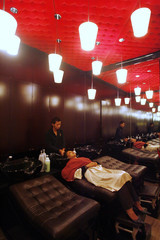 A beautician washes the hair of a customer at Le Salon in Jakarta