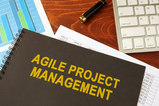 Book with title agile project management in an office.