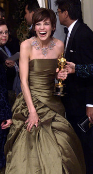 HILARY SWANK LAUGHS BACKSTAGE AT THE ACADEMY AWARDS.