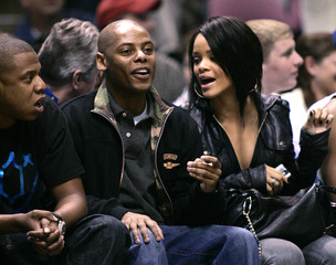 Jay Z, record producer Ty-Ty and singer Rihanna watch the Heat play the Nets in East Rutherford