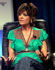 """Lisa Rinna gestures as she attends the Court TV show """"Hollywood Stalkers"""" panel in Beverly Hills."""