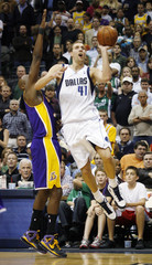 Dallas' Nowitzki is defended by Los Angeles' Odom on the shot in their NBA game in Dallas, Texas