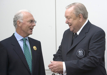 Beckenbauer, President of the Local Organising Committee chats with UEFA President Johansson during a World Cup meeting at the bavarian state chancellery in Munich