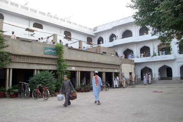 Students walk at Islamic seminary where suspected British al Qaeda operative Rauf was believed to have visited several times, in Bhawalpur